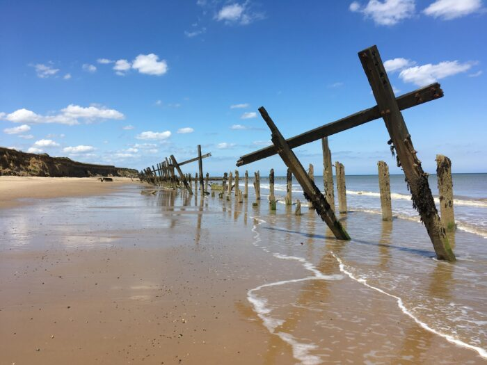 Happisburgh beach showing weathered sea-defences